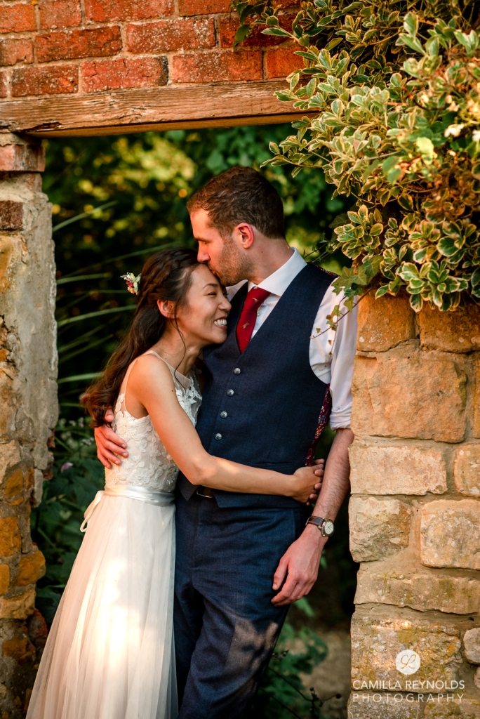 bride and groom kissing evening light natural  wedding photography