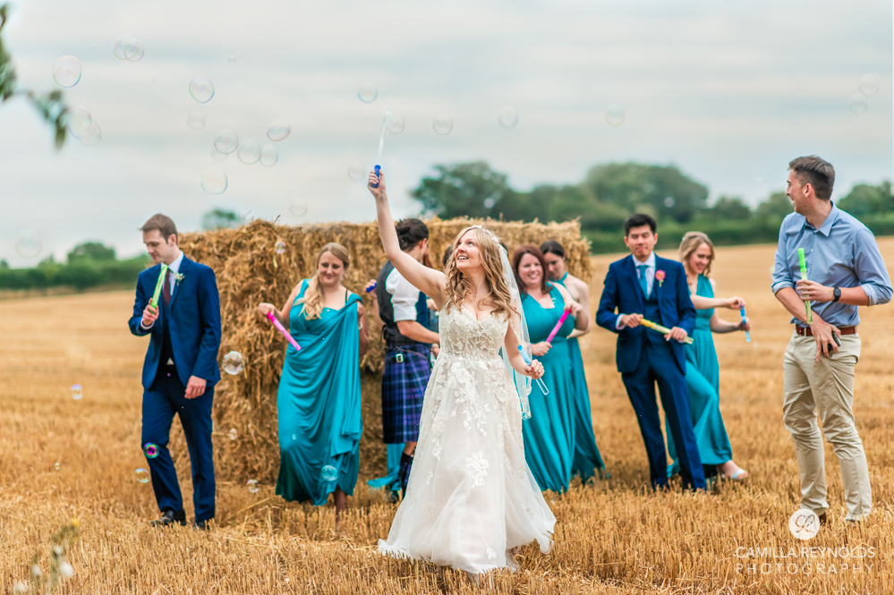 countryside field wedding with hay bales cotswold photography