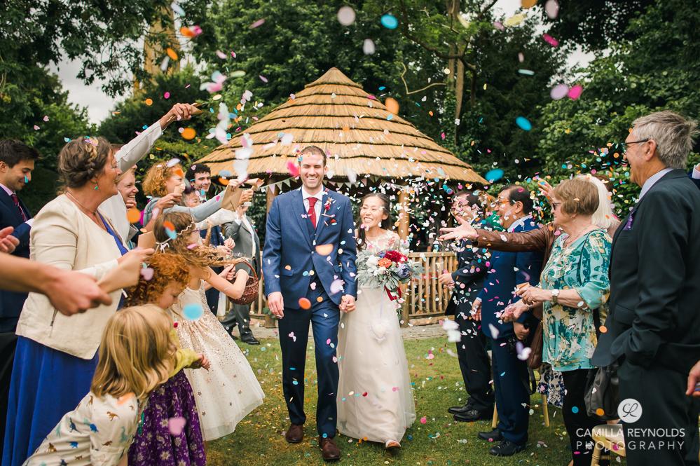 confetti shot manor house hotel wedding photography cotswolds