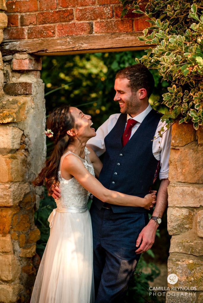 bride and groom evening light garden photo cotswold wedding