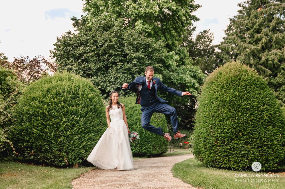 groom jumping fun wedding photography uk