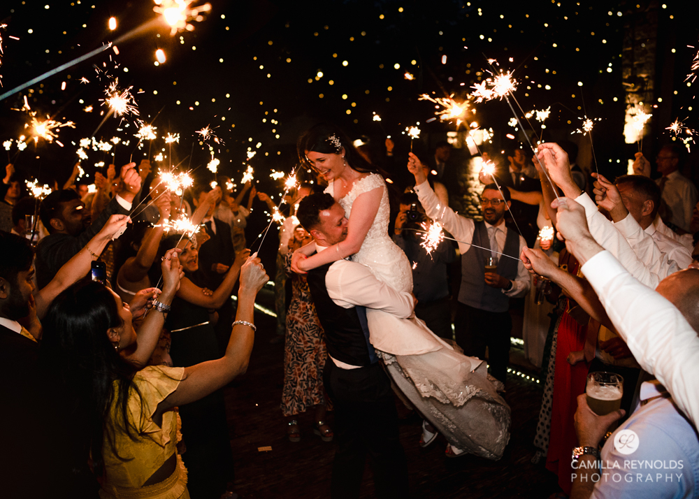 bride and groom with sparklers natural  wedding photography uk