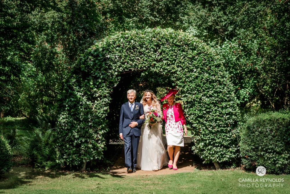 bride walking cripps barn wedding cotswolds