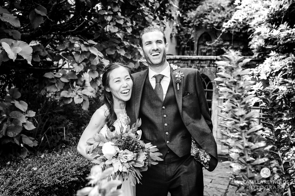 bride and groom laughing black and white wedding photography uk