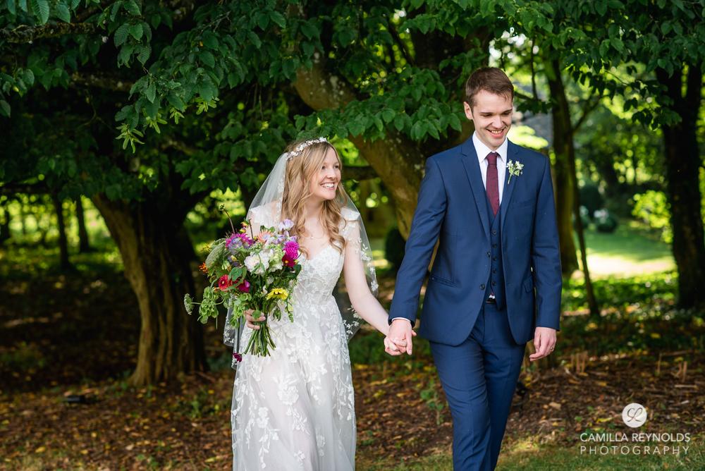 bride and groom walking natural wedding photography uk
