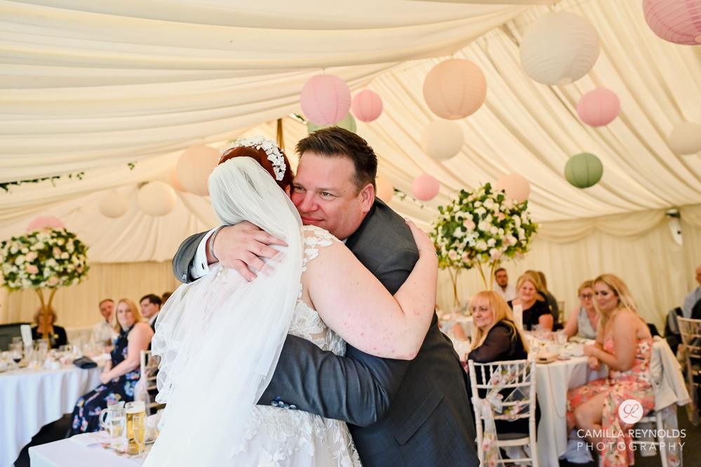 bride hugging dad natural wedding photography cotswolds
