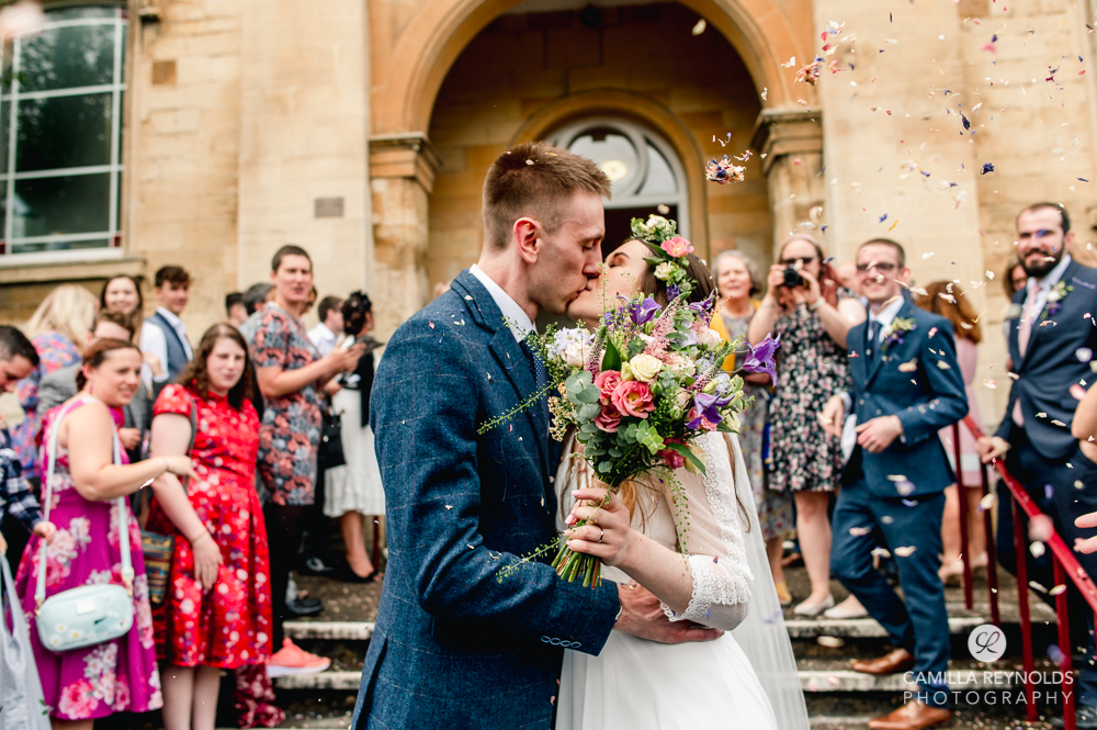 bride and groom kissing natural wedding photography Cotswolds uk