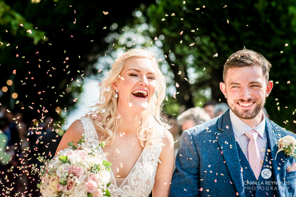 bride and groom happy laughing confetti shot wedding uk