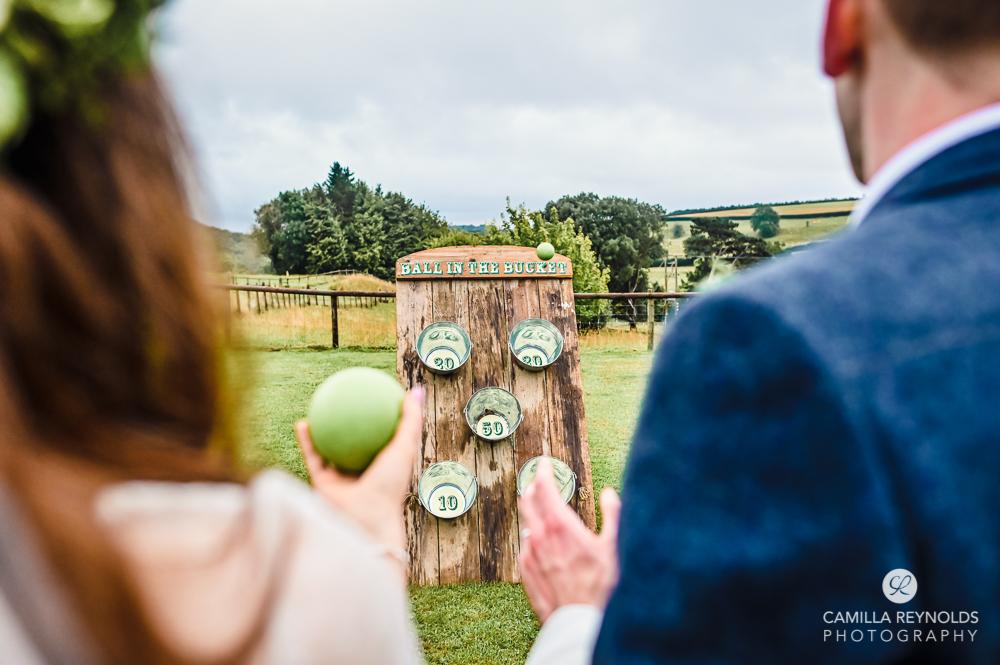 bride and groom games paddock Kingscote barn natural wedding photography