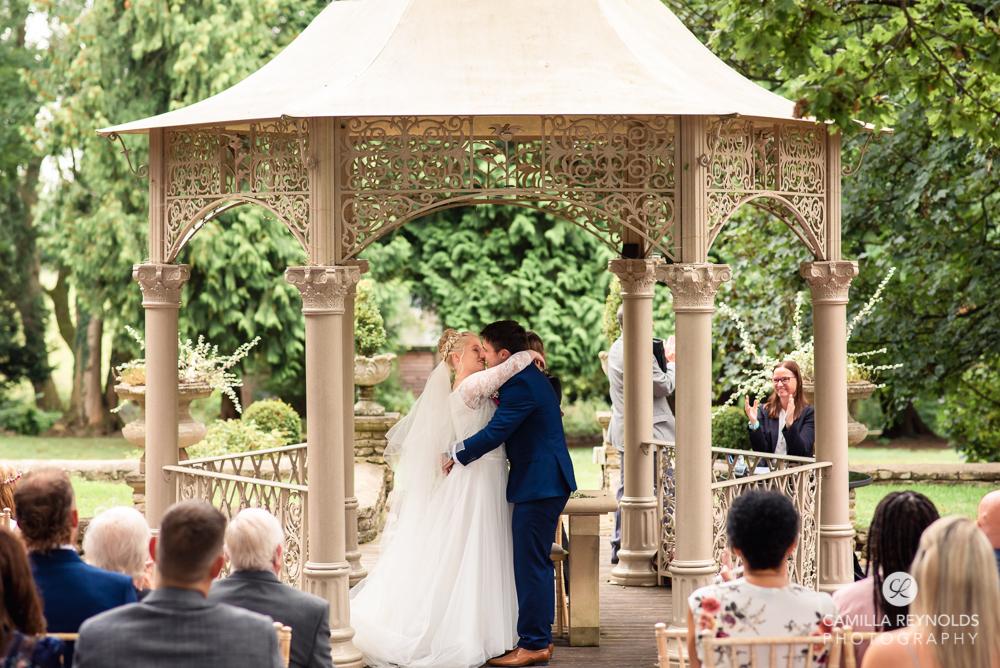first kiss outdoor wedding ceremony photography eastington park uk