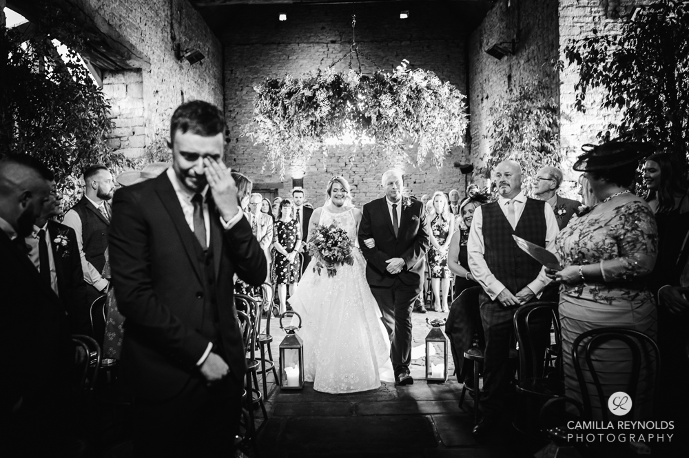 bride walking down the aisle cripps barn cotswold wedding