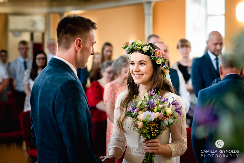 bride and groom saying wedding vows at christ church nailsworth gloucestershire uk
