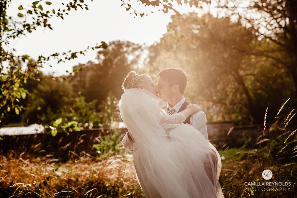 bride and groom kissing golden hour wiltshire wedding