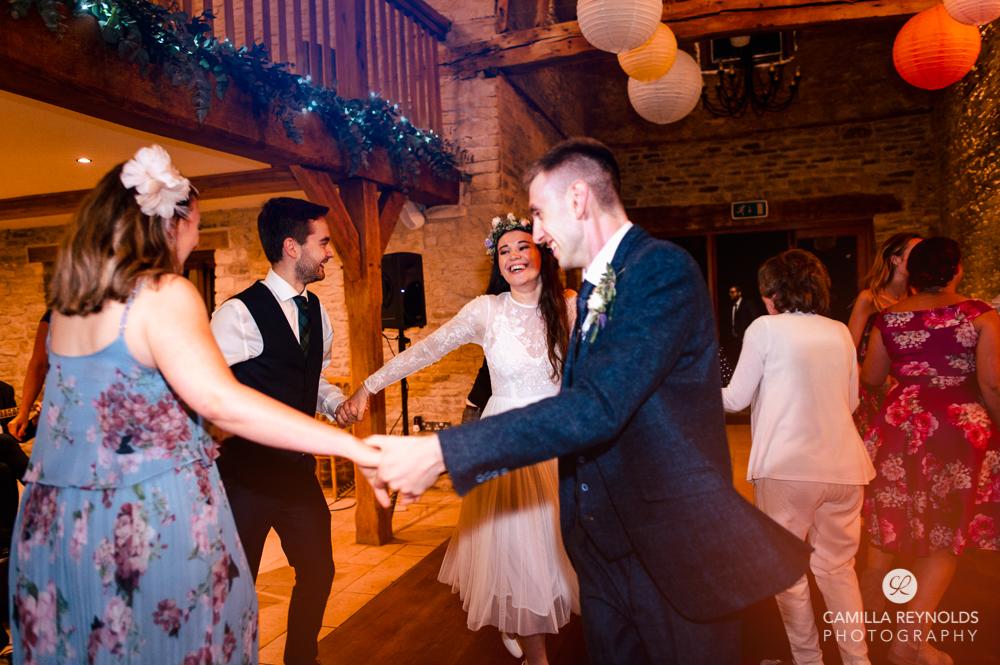 barn ceilidh dancing  at Kingscote  wedding tetbury uk