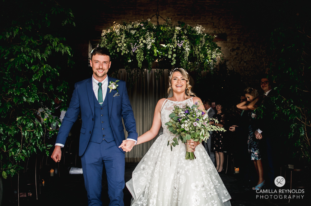 bride and groom walking cripps barn gloucestershire photography