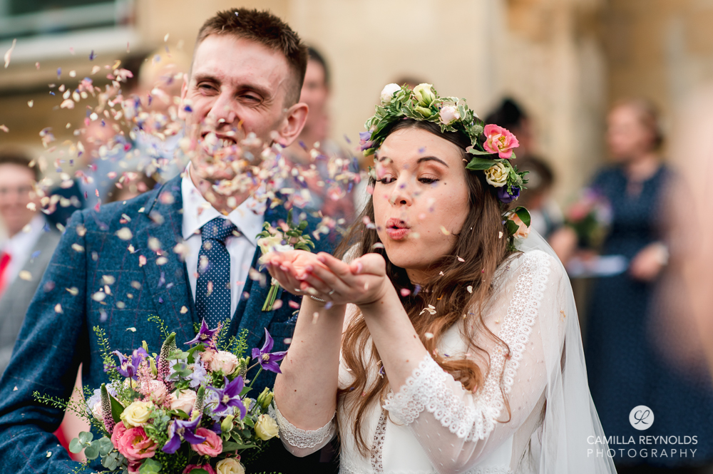 bride  blowing confetti natural wedding photography Cotswolds uk