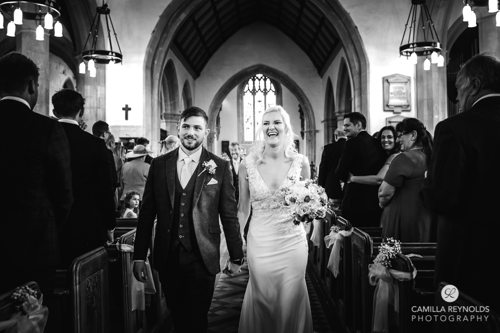 bride and groom St Marys church Painswick Gloucestershire