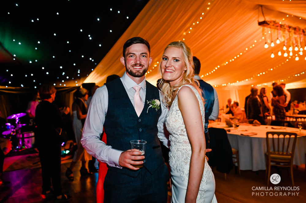 bride and groom dancing colourful wedding disco cotswolds uk