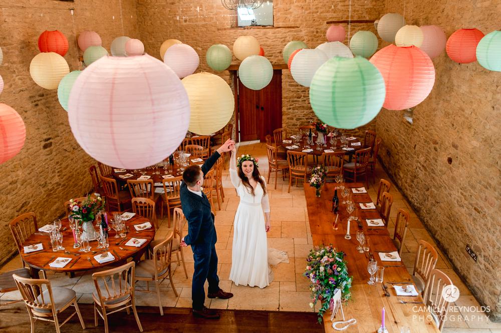 bride and groom dancing at Kingscote barn  wedding photography cotdwolds uk