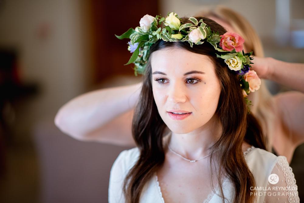bride wearing flower crown wedding at Kingscote barn gloucestershire