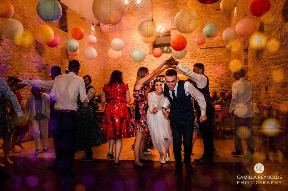bride and groom barn dancing Cotswolds uk