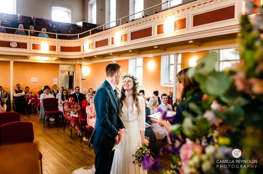 bride and groom wedding ceremony at christ church nailsworth gloucestershire uk