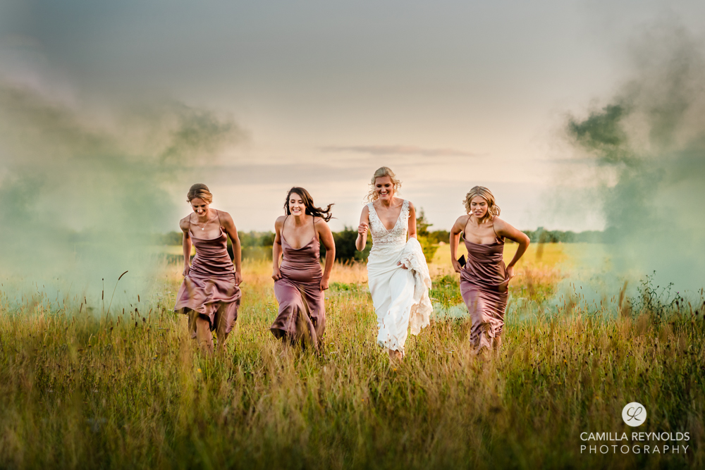 bride and bridesmaids in the field colourful wedding photography uk