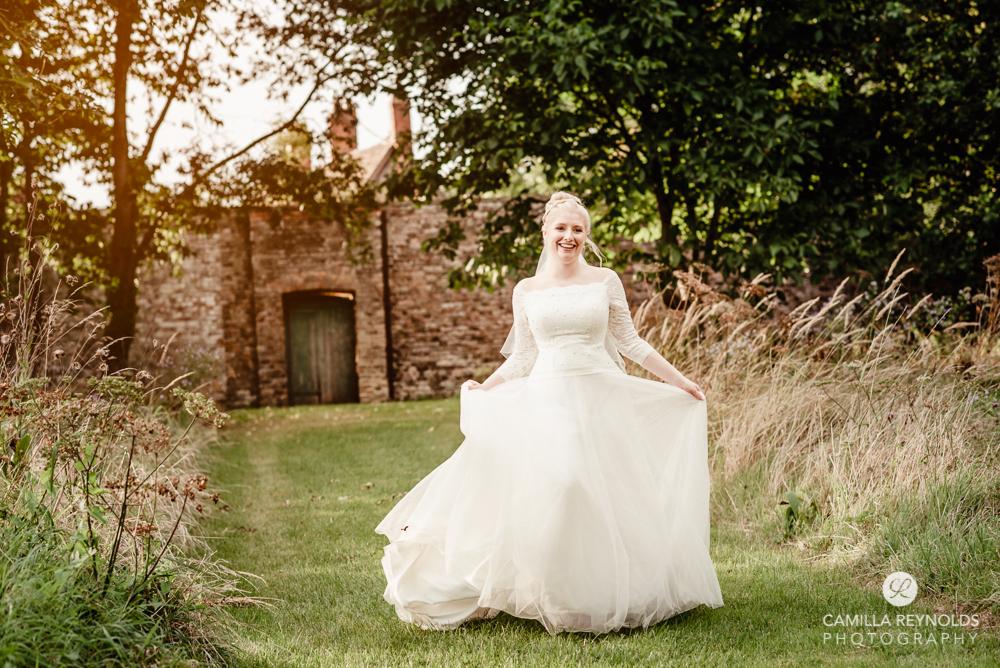 bride running castle romantic wedding photography cotswolds uk