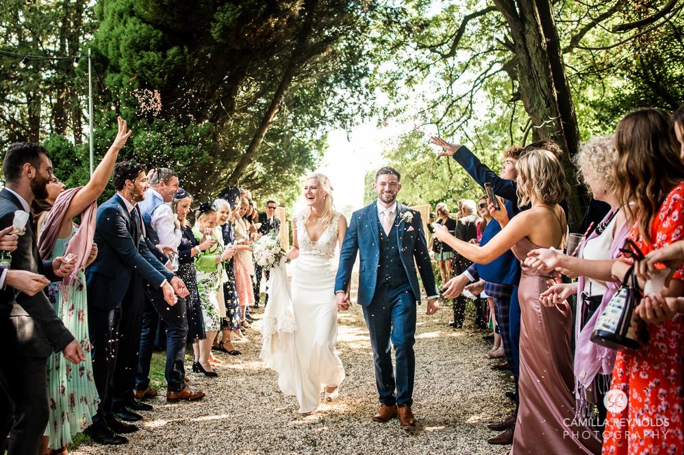 bride and groom confetti shot Painswick uk